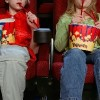 People eating popcorn at the movies.