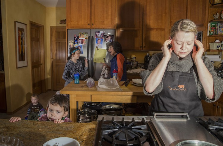 Woman bothered by noise in kitchen