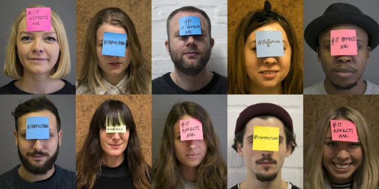 People pose with Post-Its on their faces