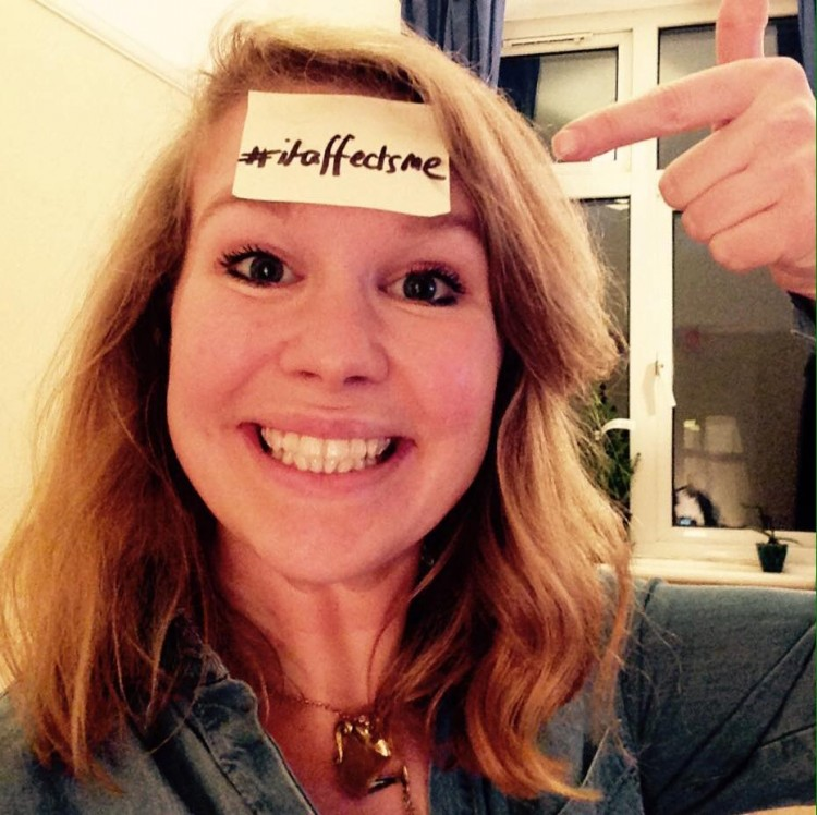 Laura Darrall poses with a Post-It on her forehead