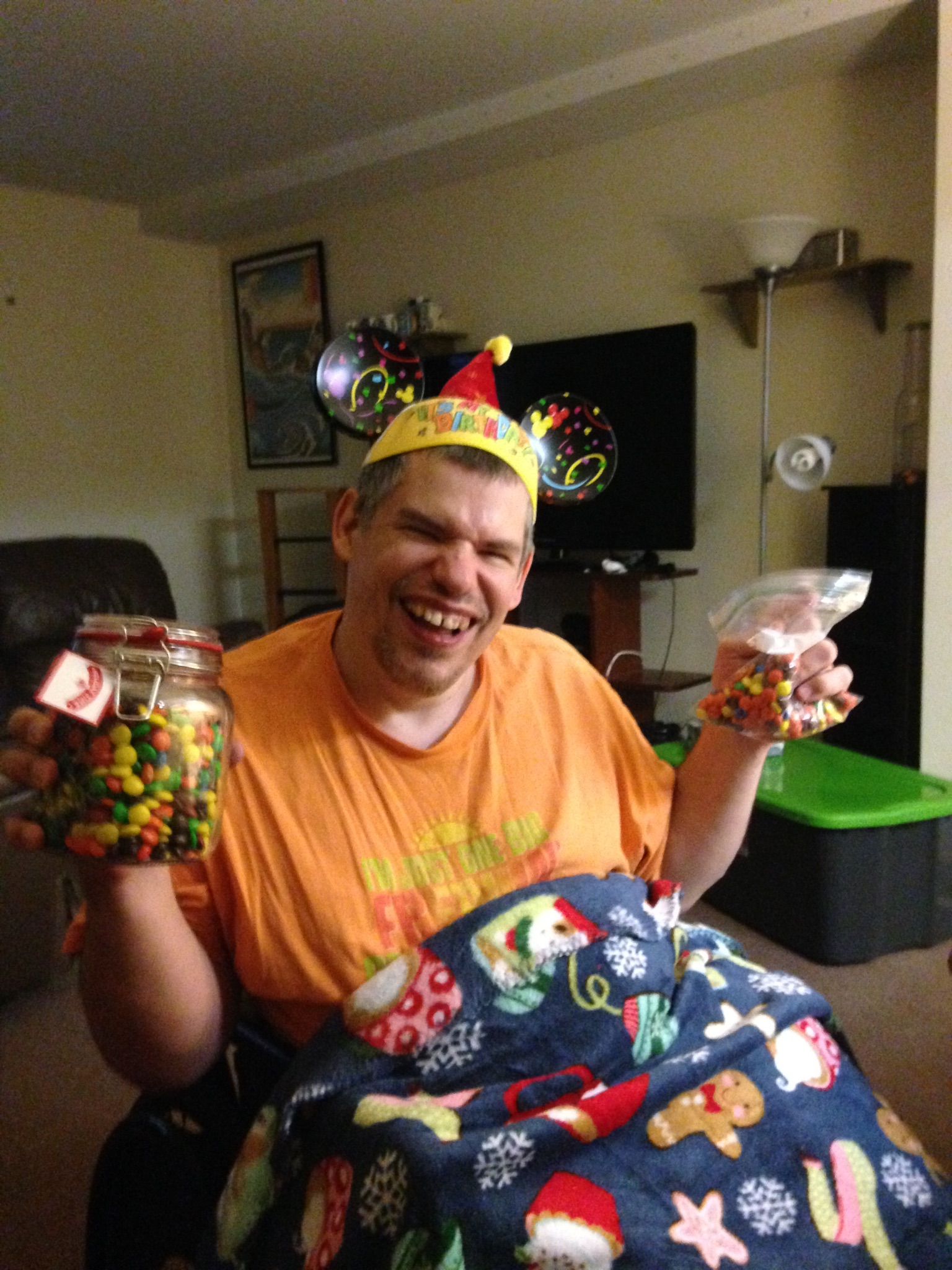 Mandy's friend Bill holding a jar of Reese's Pieces and M&M's