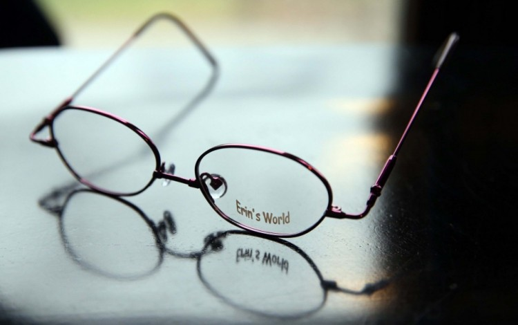 A pair of Erin's World glasses, by Specs4us, designed by Maria Dellapina
