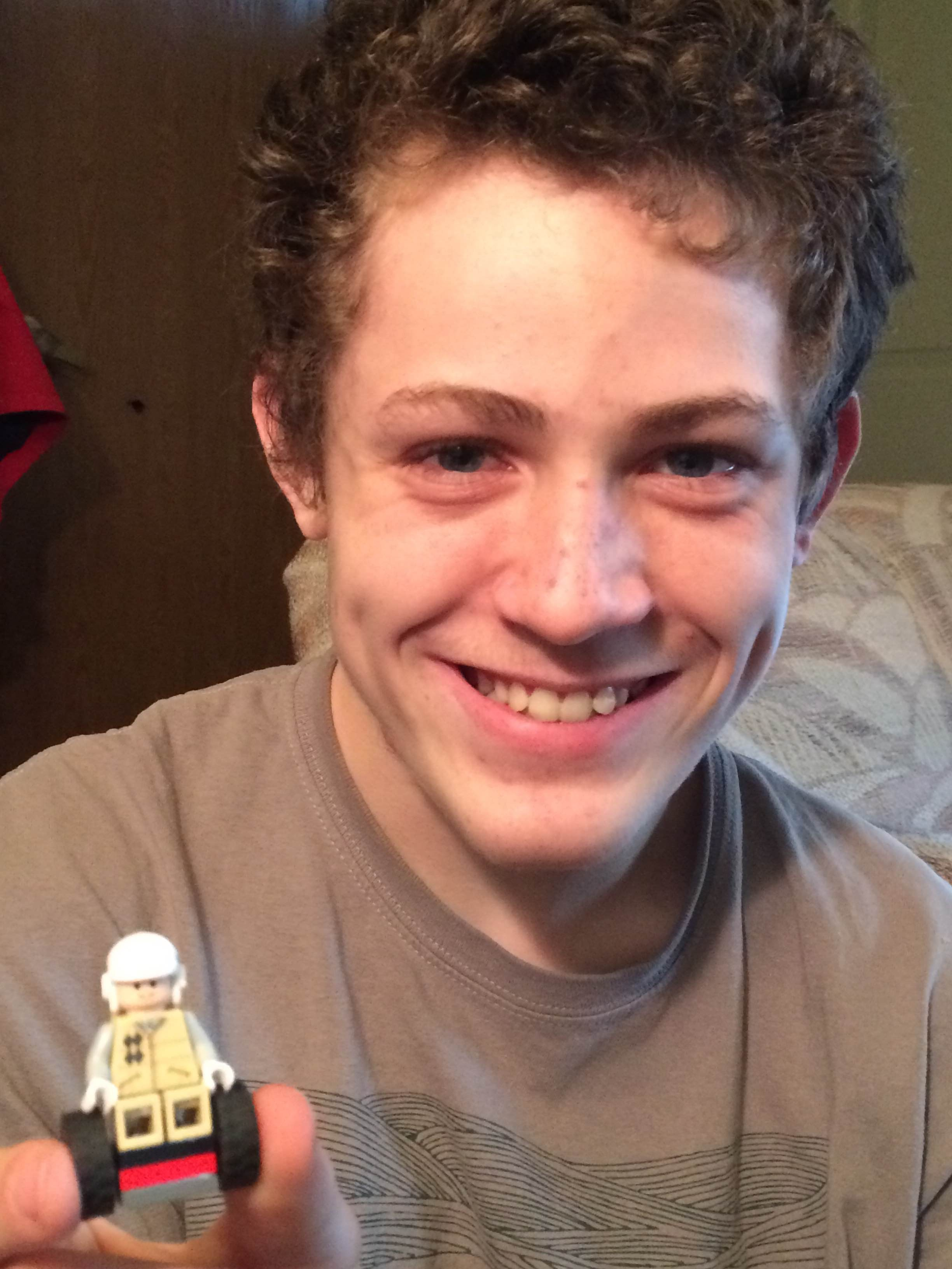 teen with lego he made