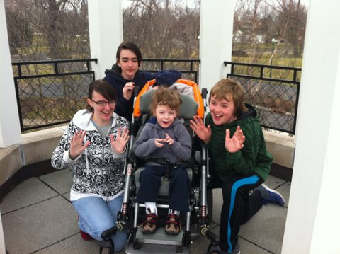Mary Ann and her three younger siblings in a gazebo