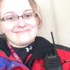 Woman wearing EMT uniform