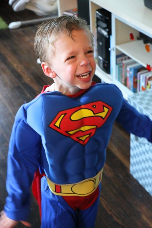 boy wearing superman costume
