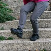 Woman stumbles on a staircase.