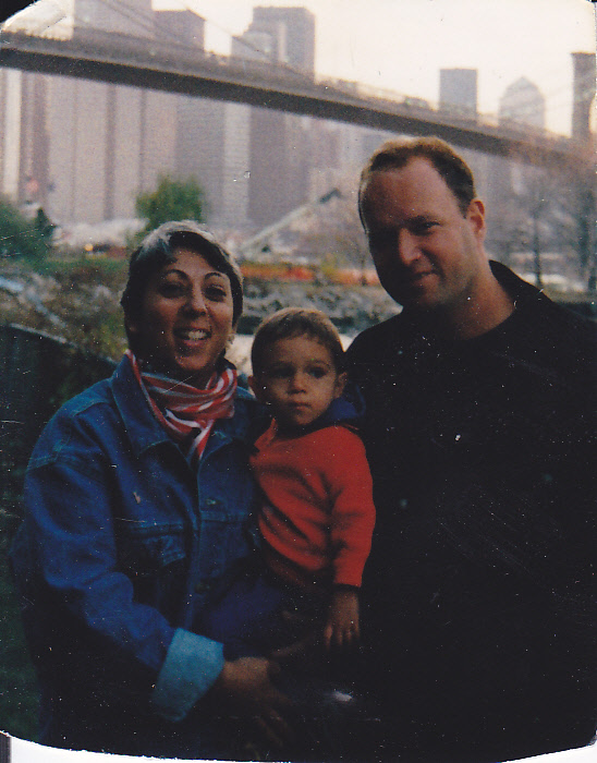 family in front of new york city skyline