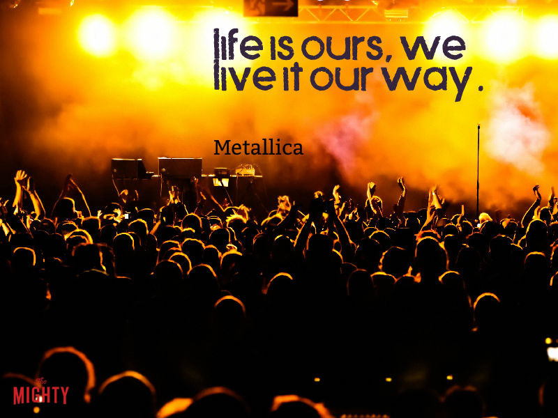 "Photo of concert that reads ""Life is ours, we live it our way."""