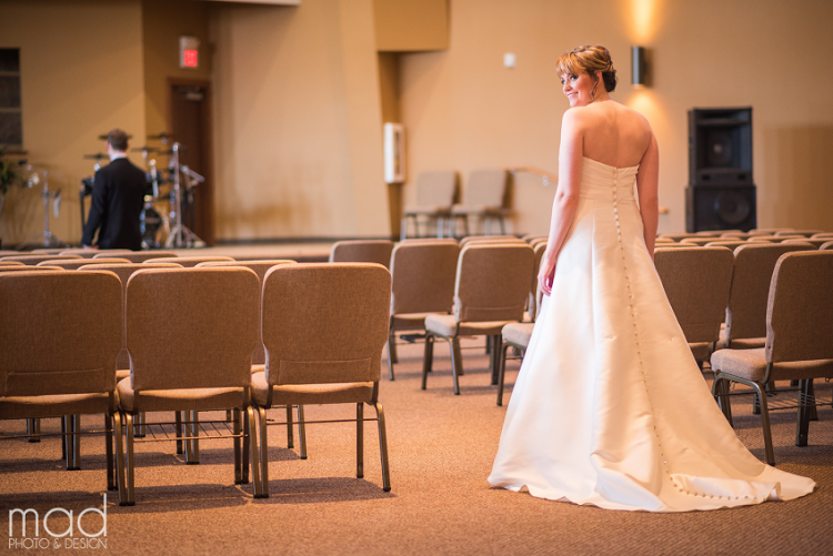 A photo of the bride taken from behind.