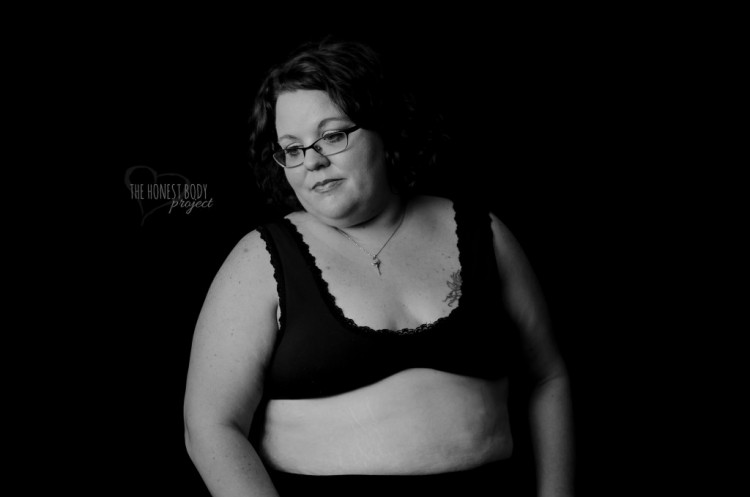 Somber woman poses in her underwear