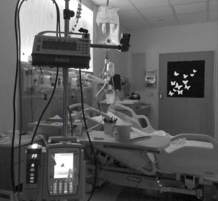 Hospital room with bed and machines