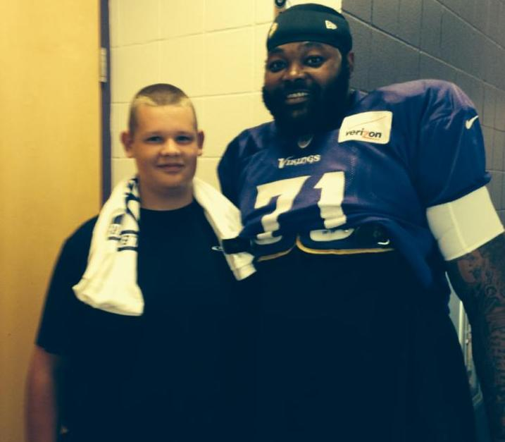 Tucker and Phil Loadholt of the Minnesota Vikings
