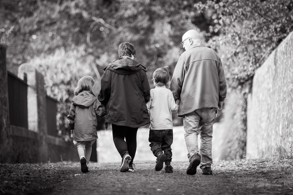 family of four walking from behind