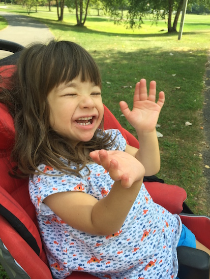 Hillary's daughter Esmé in a park
