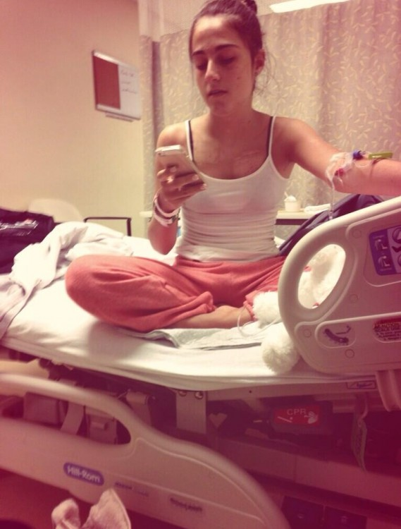 Girl sitting in hospital bed