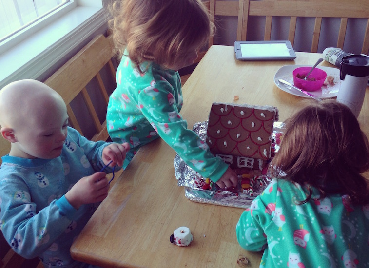 Johanna's three daughters putting together a gingerbread house