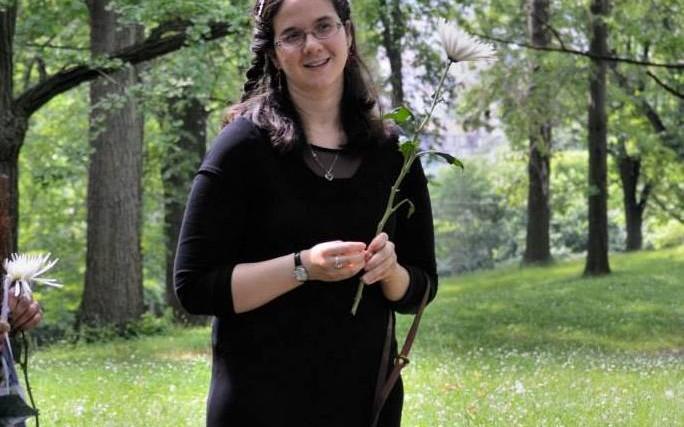 woman wearing black standing in green field