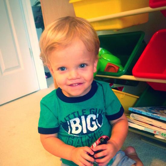 little boy wearing green shirt