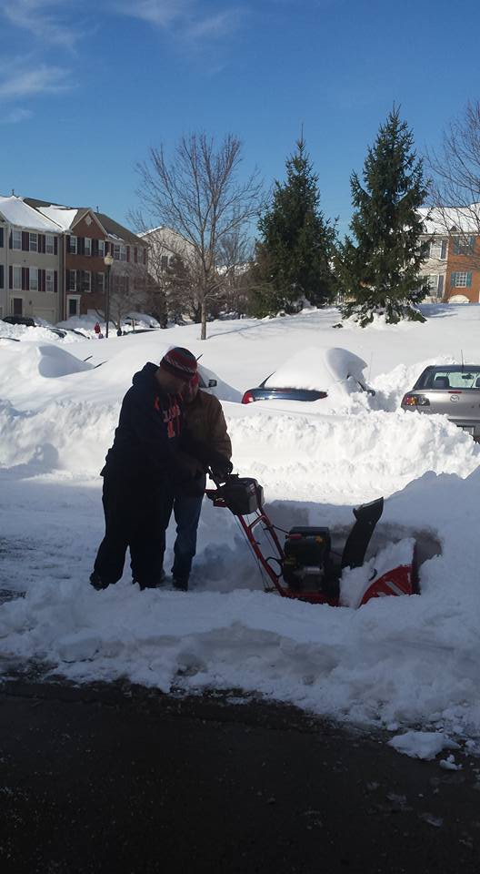 neighbor plowing with snowblower