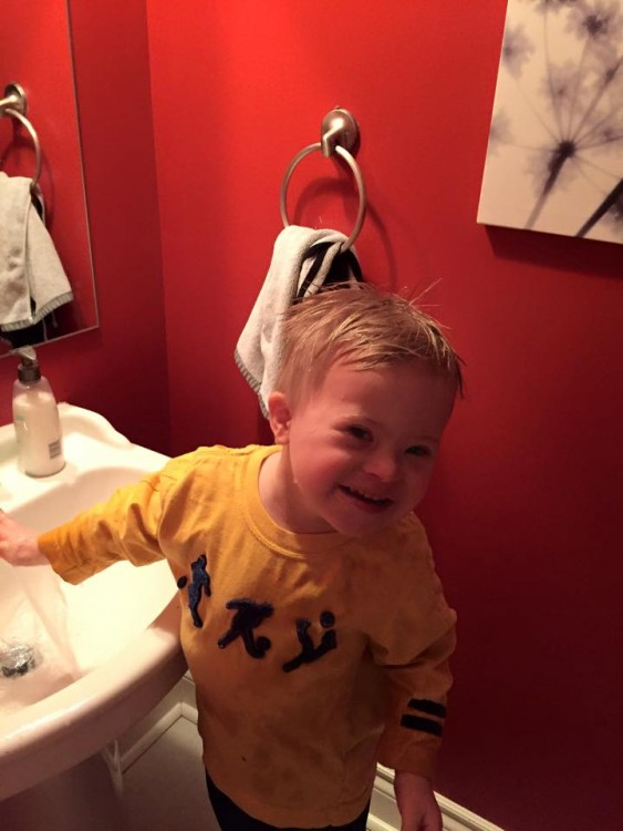 young boy in bathroom with blonde hair