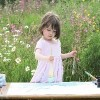 young girl painting outside