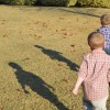 boys walking on grass