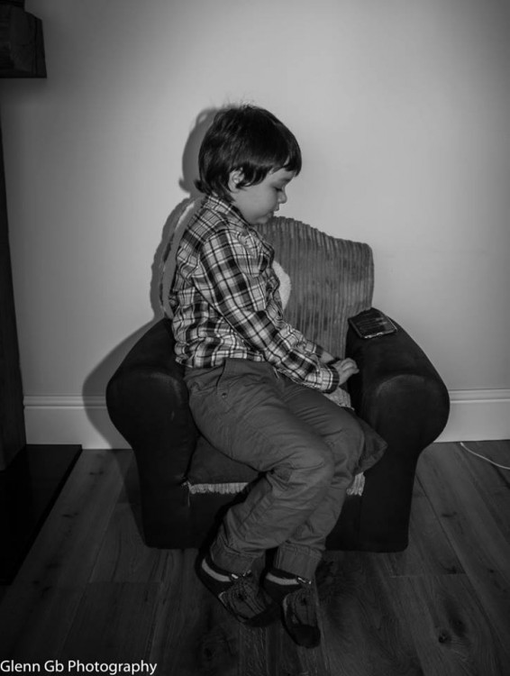 Photo of a young boy in a chair.