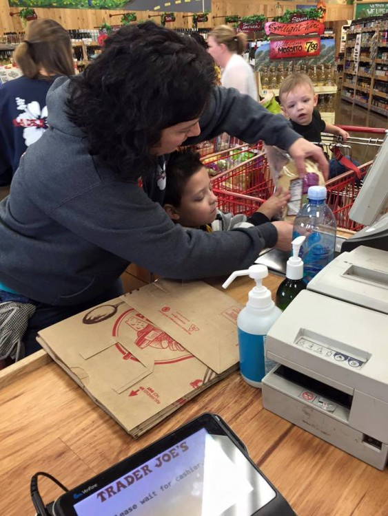 Cashier interacting with little boy.