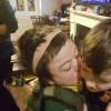 boy kissing his brother on the cheek