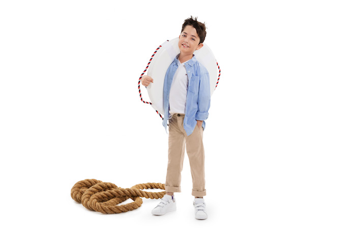 Boy wearing adaptable clothing.