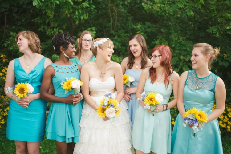 bride with bridesmaids wearing blue dresses