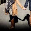 man and woman holding handsa