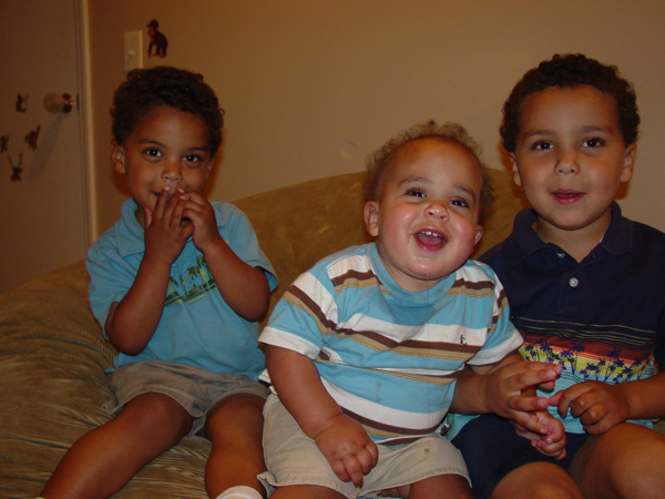 three young boys sitting together