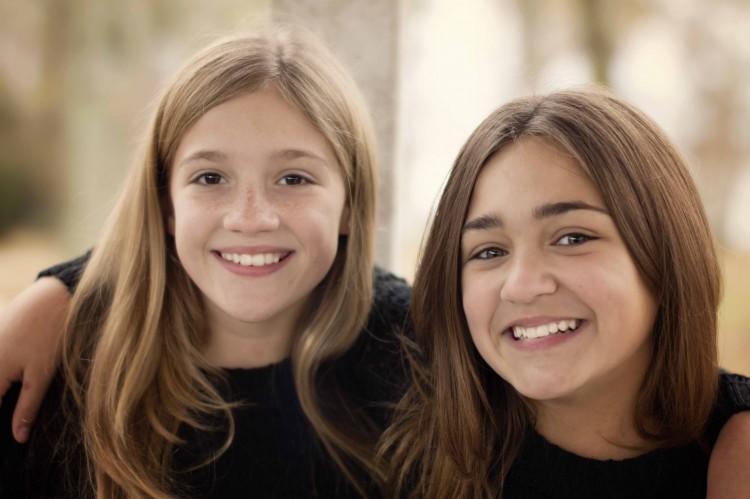 two teenage girls smiling