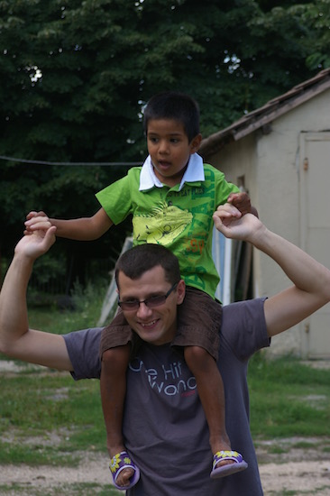 man holding boy on shoulders