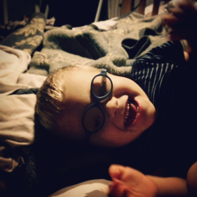 boy in glasses smiling