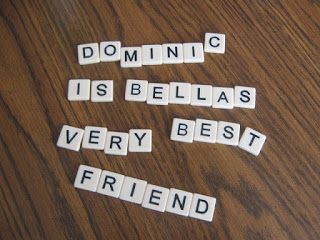 letter tiles that spell out Dominic is Bellas very best friend
