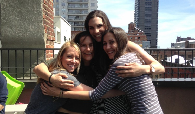 group of four girls hugging