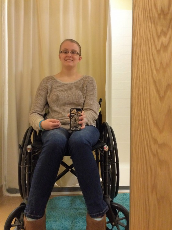 young woman smiling and sitting in wheelchair