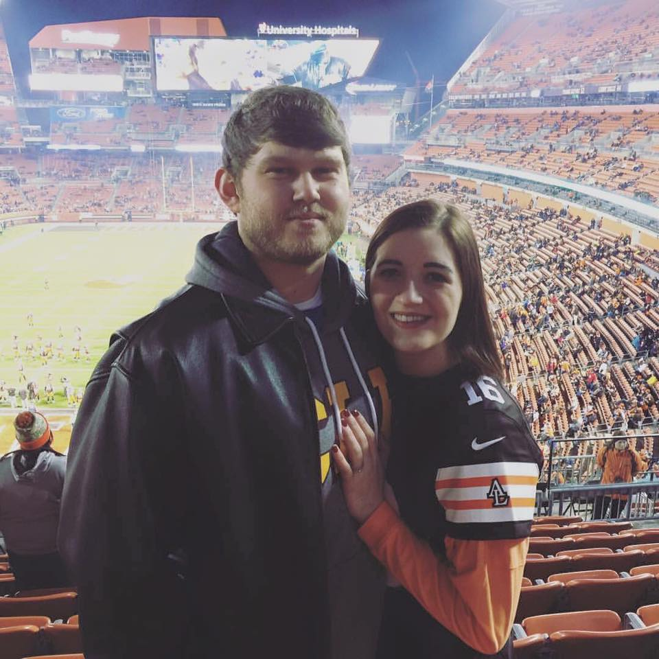Couple in sports arena stadium