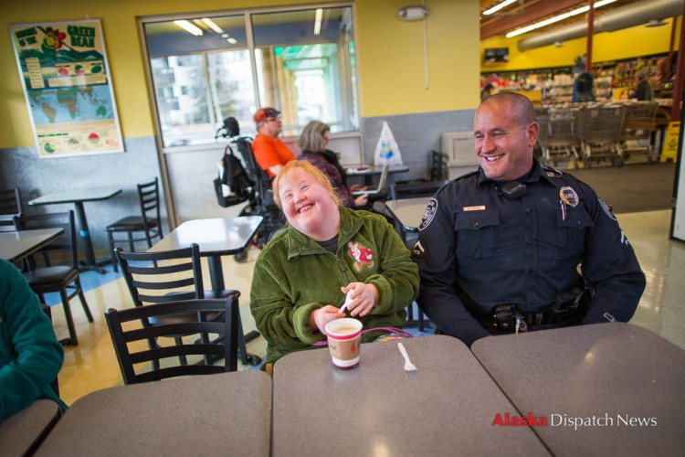 LOREN HOLMES / Alaska Dispatch News Harley Hamilton, a senior at West High living with Down syndrome and autism, meets with Anchorage police officer Matt Fraize at Sagaya City Market on Wednesday, Feb. 24, 2016. Hamilton's mother, Mallory, wanted Harley to meet a police officer so she would learn to trust them in the event they were called to a situation where they would have to interact with her.