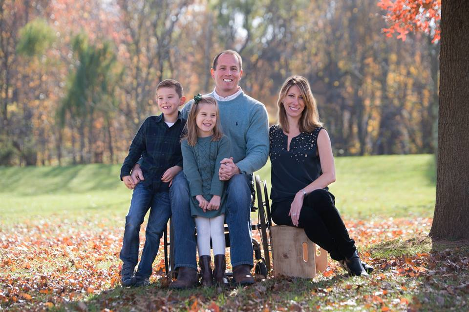 Family (husband, wife, son and daughter) in a park