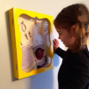 girl looking at picture frame