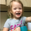 toddler girl talking and using sign language
