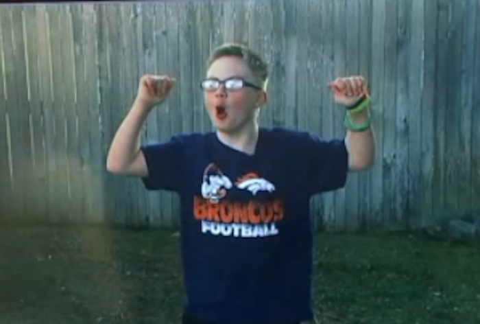 Boy with a Bronco's shirt on