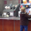 boy at soda self serve