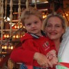 mom and young son on merry go round
