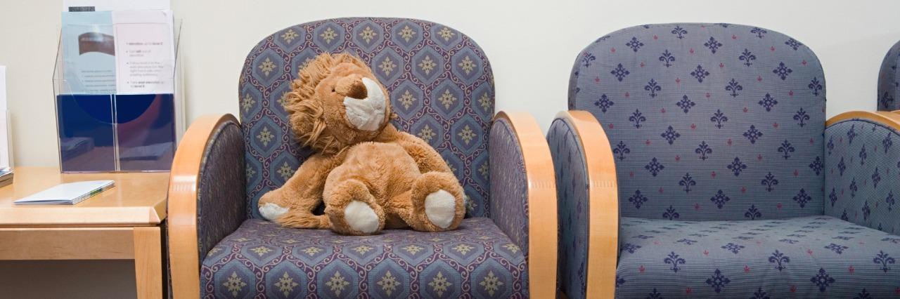 Lion stuffed animal on chair in hospital waiting room