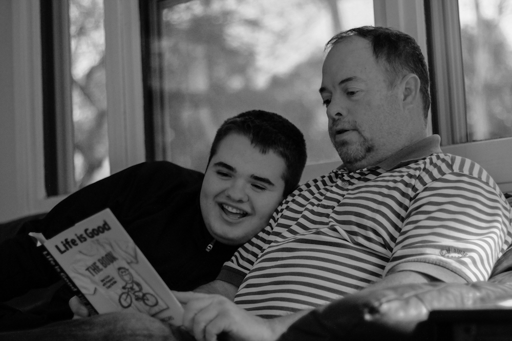 Tucker and his dad, Dennis actively practice the 10 Superpowers of Optimism_photo courtesy of Michelle Delzer Photographer